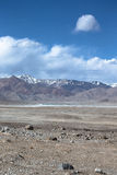 The valley at the foot of the mountains on Pamir. Spring. Tajiki Stock Photos