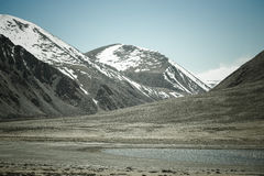 The valley at the foot of the mountains on Pamir. Spring. Tajiki Stock Image