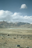 The valley at the foot of the mountains on Pamir. Spring. Tajiki Royalty Free Stock Photography