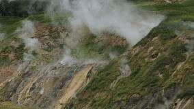 Valley of Geysers in Kamchatka Peninsula. Valley of Geysers. Kamchatka Peninsula in the summer stock footage