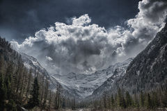 Valley, glacier and storm clouds in background Stock Photos