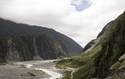 River valley leading to the Fox Glacier in New Zealand. The valley going to the Fox Glacier of the South Island of New Zealand Royalty Free Stock Image