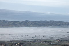 Valley half filled by fog Stock Photos