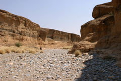 Valley hike. Dry riverbed in a gorge, Sesriem Canyon, of the namibian desert stock photography