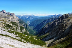 A Valley between Jagged Peaked Mountains in the Alps Stock Photography