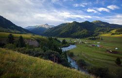Central Tien Shan. The valley of the Karkara River, along the river passes the state border between Kazakhstan and Kyrgyzstan. In the valley there are basic royalty free stock photography