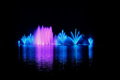 The valley of lake Abrau.Fountain on the water. Lighted fountain in the valley of lake Abrau Stock Photo
