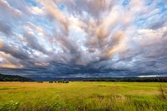 Valley Landscape With Yellowed Grass And Bizarre Clouds In The Floodplain Of The Columbia River In Columbia Gorge National Reserve Stock Photos