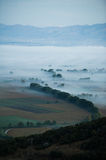 Valley in the mist Stock Photo