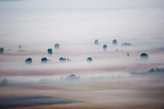 Valley in the mist. An agriculture valley covered by morning mist stock photography