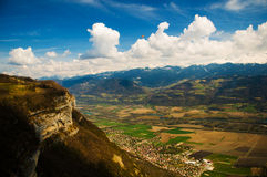 The valley between the mountains. The panorama of the valley between two massifs in Alps with the parachutists in the blue sky near Grenoble (France Royalty Free Stock Images