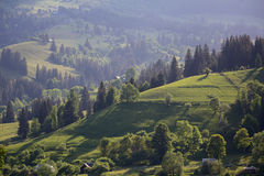 Valley and the mountains are illuminated by the sun. Carpathians Stock Photos