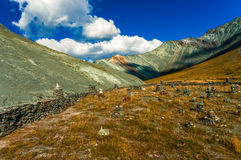 Valley in the mountains with stone altars in the summer sunny day. Type in the transition to the pass Ak-kem, Altai Royalty Free Stock Images