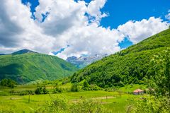 In a valley among the mountains there is a small village. Stock Photos