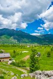 In a valley among the mountains there is a small village. Royalty Free Stock Photos