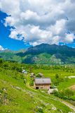 In a valley among the mountains there is a small village. Royalty Free Stock Photography