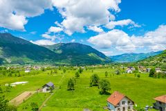 In a valley among the mountains there is a small village. Stock Photo