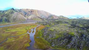 Valley National Park, aerial view. Landmannalaugar. On the gentle slopes of the mountains are snow fields and glaciers. Magnificen. Wide angle aerial view of stock video