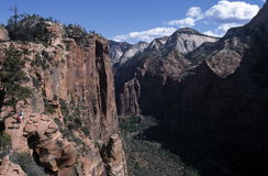 Valley Overlook. An inspiring view from an overlook on at scenic trail in Zion National Park, Utah.  Hikers can be seen in the distance Royalty Free Stock Photography