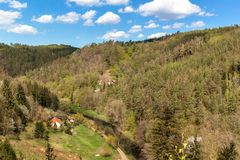 Valley with the river in the Czech Republic. Spring day in nature. View of the valley on the river. Wooded hills.  royalty free stock photography