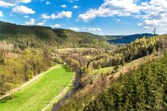 Valley with the river in the Czech Republic. Spring day in nature. View of the valley on the river. Wooded hills.  stock photo