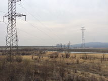 Valley. The river valley and power towers Royalty Free Stock Image