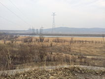 Valley. The river valley and power towers Stock Photography