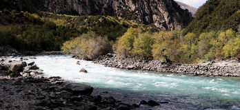Valley river in tibet. Scenic view of niyang river, Tibet, China. A river flowing in a valley Stock Photos