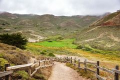 Valley road in the Headlands area on a foggy summer day, Golden Gate National Recreation Area, Marin County, California stock photography