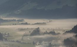 Morning in Salzach Valley in Austria. The valley of the Salzach in the morning mist during sunsrise in Salzburger Land in Austria Stock Photography