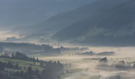 Salzach Valley in Alps Austria. The valley of the Salzach in the morning mist during sunsrise in Salzburger Land in Austria Royalty Free Stock Images