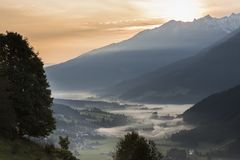 Salzach Valley Wald in Pinzgau. The valley of the Salzach in the morning mist during sunsrise in Salzburger Land in Austria Stock Image