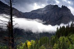 Cloud Band Across The Mountain. Valley shrouded with cloud in the fall splendor at Glacier National Park, Montana Royalty Free Stock Photos