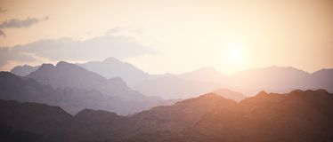 Mountains in the Sinai desert at sunset. Valley in the Sinai desert with mountain rock at sunset Stock Photography