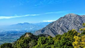 Mountain view vaishno devi katra Jammu india. Valley sky background city nature trees greens rock beautiful beauty landscape worship religious travel trip royalty free stock image