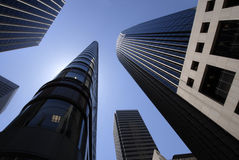 In the Valley of Steel and Glass. Wide angle view of five skyscrapers looming overhead in San Francisco Royalty Free Stock Photography