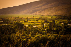 Valley in the summer haze. Panoramic view of the valley in the summer haze Stock Images