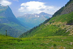 Valley surrounded by snow-capped mountains. Royalty Free Stock Photography