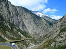 Valley in Swiss Alps. With winding road stock photo
