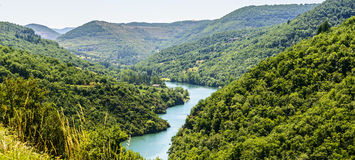 Valley of Tarn (Midi-Pyrenees). The valley of the Tarn river between Millau and Albi (Aveyron, Midi-Pyrenees, France) at summer Royalty Free Stock Images