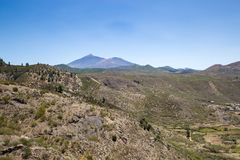 Valley in Teno Mountains with Teide Mountain in the Background, Tenerife, Spain Royalty Free Stock Photo