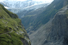 Valley, trail and glacier nearby Grindelwald in Switzerland royalty free stock images