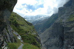 Valley, trail and glacier nearby Grindelwald in Switzerland stock image
