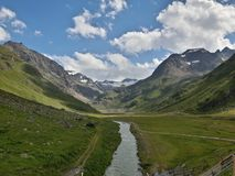 Valley of tranquility. A beautiful valley in the center  of the alps Royalty Free Stock Photo