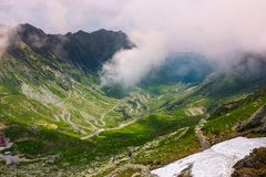 Valley of Transfagarasan route in summertime. Gorgeous view from the top through the clouds royalty free stock image