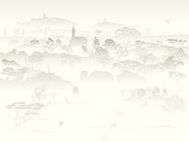 Valley with trees and farm in a morning fog. Royalty Free Stock Image