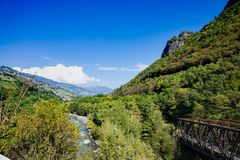 Valley in Trentino, railway bridge and bicycle path over river Adige, Italy royalty free stock photography