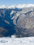Valley under snowy alpine peaks Royalty Free Stock Photos