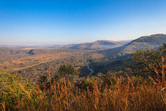 Valley Wildlife Parks Landscape. Blue sky and african bush vegetation with scenic colors contrasting in the morning sunlight overlooking the valley river nzimane Stock Image