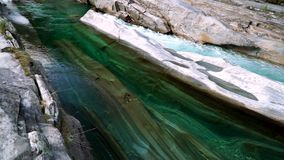 The valley of the Verzasca river with clear water. Lavertezzo, Switzerland. Movement of the camera using a Steadicam stock footage